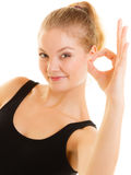 Fitness sporty girl showing ok okay hand sign gesture Stock Images
