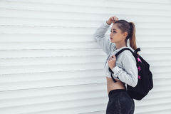 Fitness sporty girl wearing fashion clothes royalty free stock photography
