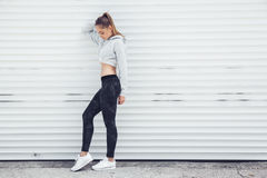 Fitness sporty girl wearing fashion clothes royalty free stock images
