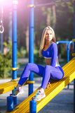 Fitness sporty model woman during outdoor exercises workout. Beautiful fit girl. Healthy lifestyle. Royalty Free Stock Images