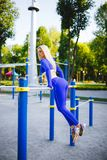 Fitness sporty model woman during outdoor exercises workout. Beautiful fit girl. Healthy lifestyle. Stock Photography