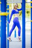 Fitness sporty model woman during outdoor exercises workout. Beautiful fit girl. Healthy lifestyle. Fitness sporty model woman during outdoor exercises workout royalty free stock photos