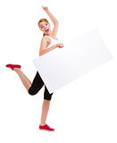 Fitness sporty woman holding blank empty ad banner. Fitness and health lifestyle advertisement. Young woman girl holding blank empty banner ad copyspace isolated Stock Photo