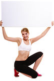 Fitness sporty woman holding blank empty ad banner Stock Photo
