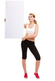 Fitness sporty woman holding blank empty ad banner Stock Image