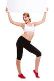 Fitness sporty woman holding blank empty ad banner Royalty Free Stock Photos