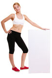 Fitness sporty woman holding blank empty ad banner Royalty Free Stock Photo