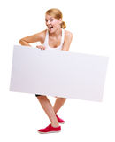 Fitness sporty woman holding blank empty ad banner. Fitness and health lifestyle advertisement. Young woman girl holding presenting blank empty banner ad Stock Images