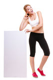 Fitness sporty woman holding blank empty ad banner. Fitness and health lifestyle advertisement. Young woman girl holding presenting blank empty banner ad Royalty Free Stock Images