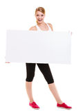 Fitness sporty woman holding blank empty ad banner Stock Photography