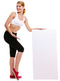 Fitness sporty woman holding blank empty ad banner. Fitness and health lifestyle advertisement. Young woman girl holding presenting blank empty banner ad Stock Photos