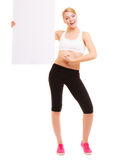 Fitness sporty woman holding blank empty ad banner. Fitness and health lifestyle advertisement. Young woman girl holding presenting blank empty banner ad Stock Photography