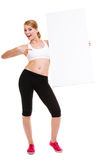 Fitness sporty woman holding blank empty ad banner Royalty Free Stock Image