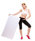 Fitness sporty woman holding blank empty ad banner Royalty Free Stock Images