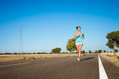 Fitness sporty woman running on road Royalty Free Stock Image