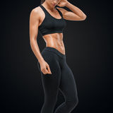 Fitness sporty woman showing her well trained body stock photos