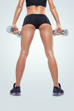 Fitness sporty woman in training pumping up muscles with dumbbells Stock Images