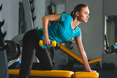 Fitness sporty young sexy Woman in gym doing exercises with dumbbells Stock Photos