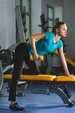 Fitness sporty young sexy Woman in gym doing exercises with dumbbells Stock Photo