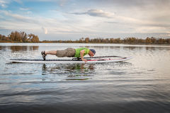 Fitness on stand up paddleboard Royalty Free Stock Photos