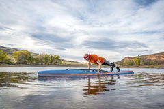 Fitness on stand up paddleboard Royalty Free Stock Images