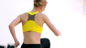 Fitness. Step aerobics closeup stock footage