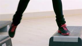 Fitness. Step aerobics closeup stock video footage