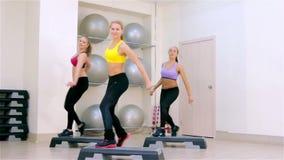 Fitness. Step aerobics stock video