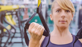 Fitness strap in the hand of woman training Royalty Free Stock Photos