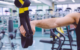 Fitness straps in the hand of man training Royalty Free Stock Photo