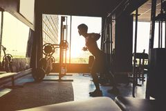 Fitness Strong Man Doing Heavy Weight exercise-machine Cable Cro Royalty Free Stock Photos