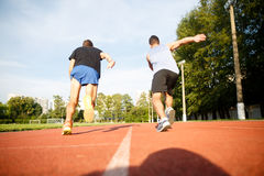 Fitness strong men jogging on running street track Stock Photography