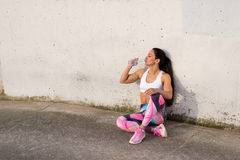 Fitness strong woman resting for drinking water Stock Photography