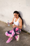 Fitness strong woman resting for drinking water Royalty Free Stock Image