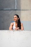 Fitness strong woman taking an urban workout rest Royalty Free Stock Photography