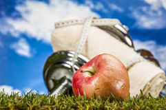 Fitness stuff, green grass Royalty Free Stock Photography