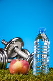 Fitness stuff with light background and friuts Royalty Free Stock Photos