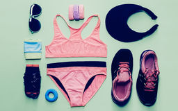Fitness style. Sports Accessory Set on green background Stock Photography