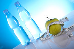 Fitness symbols. Bottles of mineral water and green apple Stock Photo