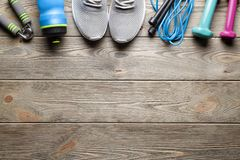 Fitness symbols on wooden board background. Fitness symbols on gray wooden board background stock photography