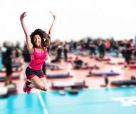 Fitness teacher jumps at the gym Royalty Free Stock Photos