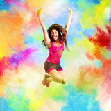 Fitness teacher jumps on summer colors Royalty Free Stock Image