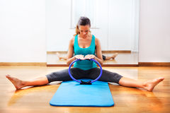 Fitness teacher making exercisese with the circle tool Stock Image