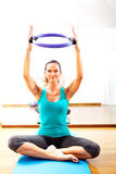Fitness teacher making exercisese with the circle tool Royalty Free Stock Photography