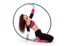 Fitness teacher posing in hula hoop Royalty Free Stock Photography