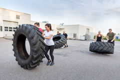 Fitness team flipping heavy tires as workout Royalty Free Stock Photography