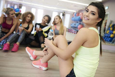 Fitness with team. Group of girls having a break over workout Stock Image