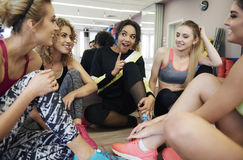 Fitness with team. Group of girls having gossips on the gym Royalty Free Stock Image