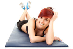 Fitness teenage girl lying on the floor Royalty Free Stock Photos