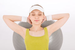 Fitness teenager woman with closed eyes Stock Photography